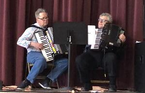Dave Doolin (left) and author Bill Schmitt (right) play their accordions at a parish festival honoring St. Joseph on March 19.